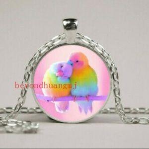 New. Rainbow birds necklace